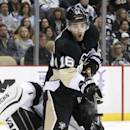 Pittsburgh Penguins' Brandon Sutter (16) can't get his stick on a shot to redirect it in front of Los Angeles Kings goalie Martin Jones (31) during the second period of an NHL hockey game in Pittsburgh, Thursday, Oct. 30, 2014. (AP Photo/Gene J. Puskar)