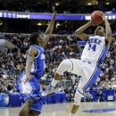 Duke's Rasheed Sulaimon, right, tries to get a shot past Creighton's Austin Chatman during the first half of a third-round game of the NCAA college basketball tournament, Sunday, March 24, 2013, in Philadelphia. (AP Photo/Matt Slocum)