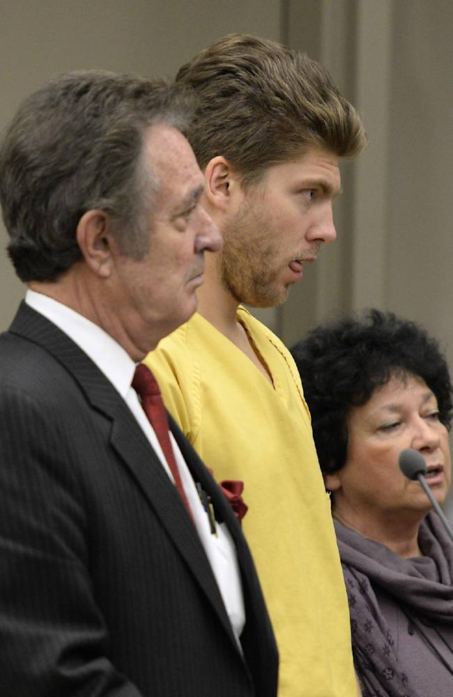Colorado Avalanche goalie Semyon Varlamov, standing between his attorney, Jack Rotole, left, and a Russian interpreter, appears in court in Denver on Thursday, Oct. 31, 2013. Varlamov will be able to travel with the team while prosecutors consider whether he should be charged with assaulting his girlfriend. On Thursday, a judge said Varlamov could be released if he posted $5,000 bond and be allowed to travel with the team but he was ordered to stay away from his girlfriend, among other restrictions
