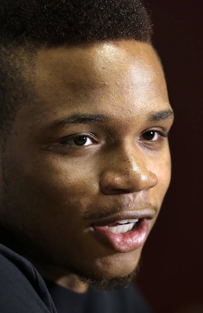 University of Massachusetts basketball guard Derrick Gordon talks with reporters on the school's campus, Wednesday, April 9, 2014, in Amherst, Mass. Gordon hopes his decision to become the first openly gay player in Division I men's basketball will inspire others