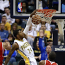 Indiana Pacers forward Paul George (24) dunks the basketball above Atlanta Hawks guard Jeff Teague (0) and forward Paul Millsap during the first half of an NBA basketball game in Indianapolis, Tuesday, Feb. 18, 2014 The Associated Press