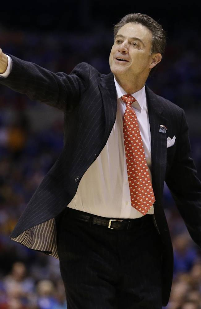 Louisville head coach Rick Pitino directs his team during the first half of an NCAA Midwest Regional semifinal college basketball tournament game against the Kentucky Friday, March 28, 2014, in Indianapolis