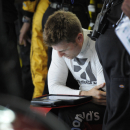 Jamie McMurray checks a tablet during practice for Sunday's NASCAR Coca-Cola 600 Sprint Cup series auto race at Charlotte Motor Speedway in Concord, N.C., Thursday, May 21, 2015. (AP Photo/Mike McCarn)