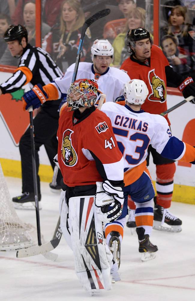 Ottawa Senators' Craig Anderson, front, and Cody Ceci skate past New York Islanders' Casey Cizikas, second from front, as he celebrates his goal during the third period of an NHL hockey game in Ottawa, Ontario, on Wednesday, April 2, 2014. (The Islanders won 2-1. AP Photo/The Canadian Press, Sean Kilpatrick)