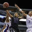 TCU's Donielle Breaux (33) goes up for a shot between Kansas' CeCe Harper, left, and Angel Goodrich (3) during the first half of an NCAA college basketball game at the Big 12 women's tournament Friday, March 8, 2013, in Dallas. (AP Photo/Tony Gutierrez)