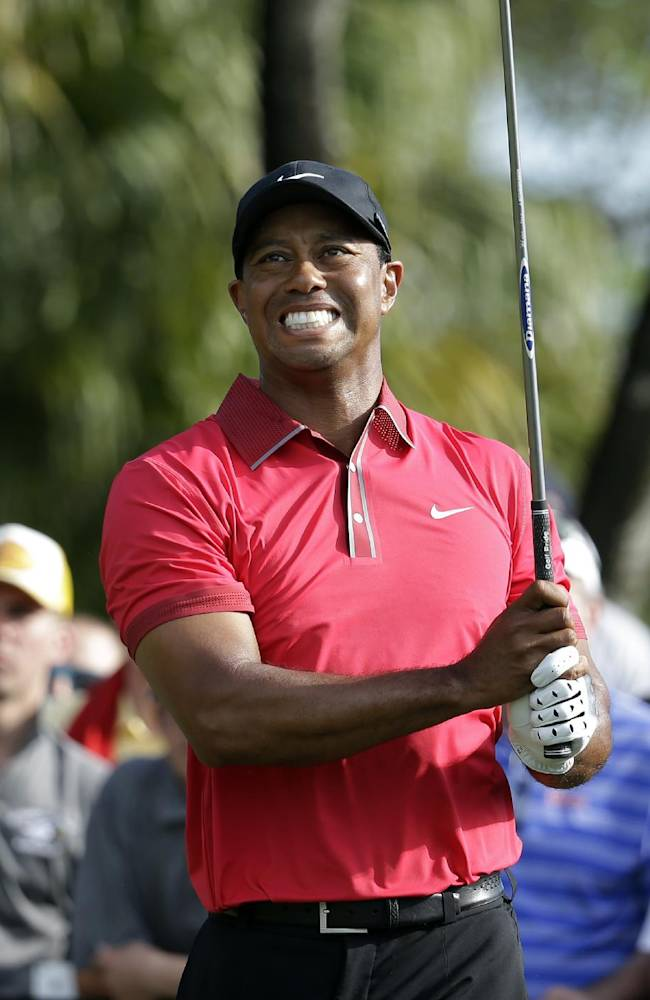 Tiger Woods watches his tee shot on the 12th hole during the final round of the Cadillac Championship golf tournament Sunday, March 9, 2014, in Doral, Fla