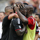 D.C. United forward Eddie Johnson, center, is embraced by his teammates after scoring during the second half of an MLS soccer match against the New York Red Bulls, at RFK Stadium, Sunday, Aug. 31, 2014, in Washington. United won 2-0 The Associated Press