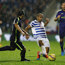 QPR's Karl Henry, right, vies for the ball with Manchester City's Sergio Aguero, left, during the English Premier League soccer match between Queens Park Rangers and Manchester City at Loftus Road stadium in London, Saturday, Nov. 8, 2014