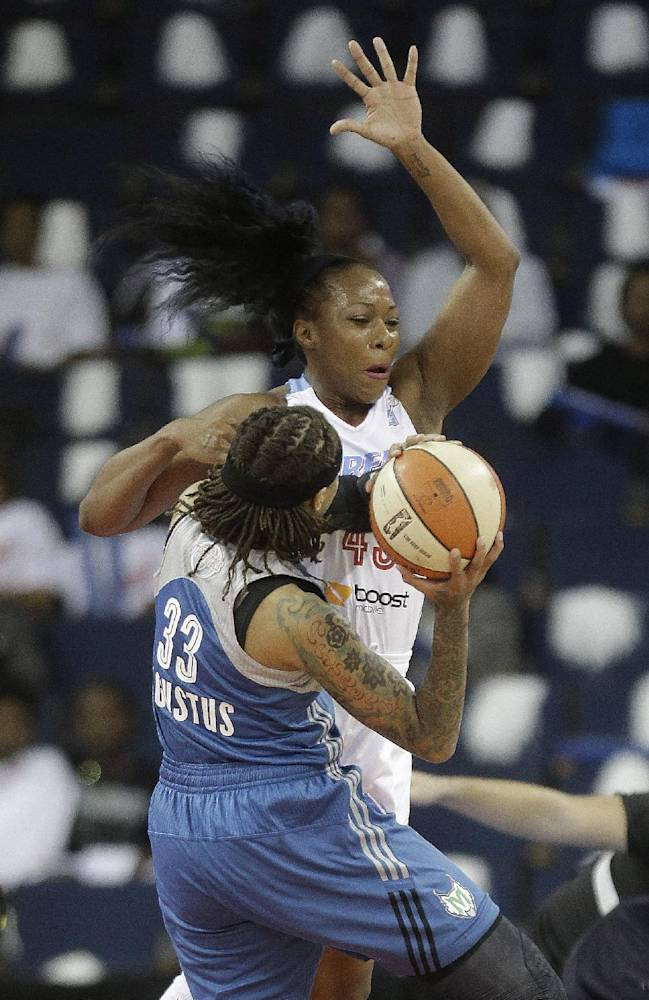 Atlanta Dream's Le'coe Willigham (43) tries to block a shot by Minnesota Lynx' Seimone Augustus (33) during the first half of Game 3 of a WNBA Finals basketball game, in Duluth, Ga., Thursday, Oct. 10, 2013