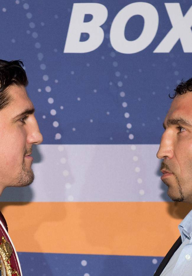 German WBO Cruiserweight Champion Marco Huck , left, faces  his challenger Firat Arslan  during a press conference in Stuttgart, Germany, Wednesday Jan 22,  2014. The WBO Cruiserweight Championship bout will take place Jan. 25