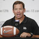 UCLA head coach Jim Mora takes questions at the 2014 Pac-12 NCAA college football media days at Paramount Studios in Los Angeles Thursday, July 24, 2014. (AP Photo)