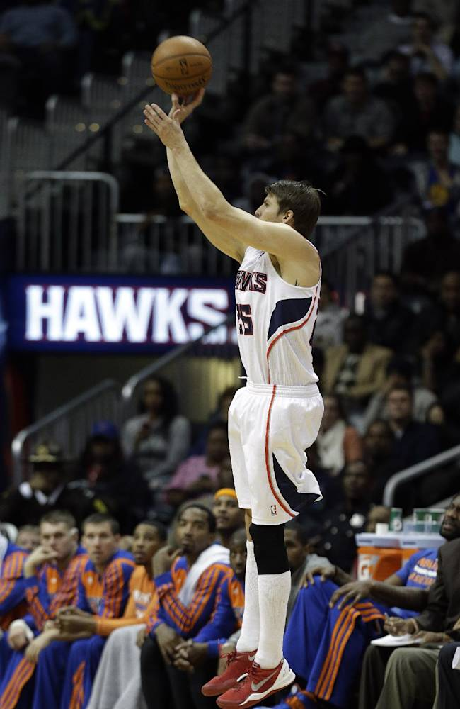 Atlanta Hawks guard Kyle Korver hits a 3-point basket to extend his streak of consecutive games with a 3-pointer, in the second half of an NBA basketball game against the New York Knicks Wednesday, Nov. 13, 2013, in Atlanta. The Knicks won 95-91