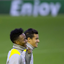 Liverpool's Raheem Sterling, left, and Philippe Coutinho smile as they train with teammates at Anfield Stadium, in Liverpool, England, Tuesday, Oct. 21, 2014. Liverpool will play Real Madrid in a Champion's League Group B soccer match on Wednesday