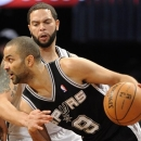 San Antonio Spurs' Tony Parker (9) drives the ball against Brooklyn Nets' Deron Williams (8) in the first half of an NBA basketball game, Sunday, Feb. 10, 2013, at Barclays Center in New York. The Spurs won 111-86. (AP Photo/Kathy Kmonicek)