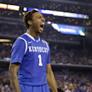 Kentucky guard James Young reacts after dunking the ball during the second half of the NCAA Final Four tournament college basketball championship game against Connecticut Monday, April 7, 2014, in Arlington, Texas. (AP Photo/David J. Phillip)