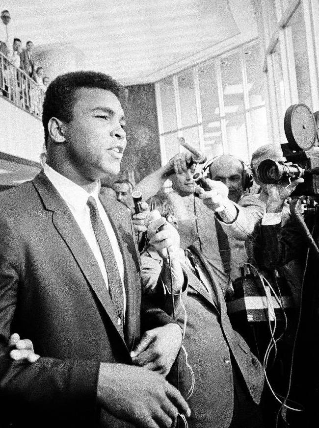 In this June 19, 1967 file photo, heavyweight boxing champion Muhammad Ali has a