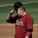 Arizona Diamondbacks starting pitcher Trevor Cahill pauses after giving up a run to the Cleveland Indians during the second inning of an exhibition baseball game in Scottsdale, Ariz., Tuesday, March 11, 2014 The Associated Press