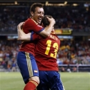 Spain midfielder Santi Cazorla, left,  celebrates with teammate Juan Mata, right,  who scored the second of two goals for Spain in the second half of an international friendly soccer match at Yankee Stadium in New York, Tuesday, June 11, 2013.  Spain defeated Ireland 2-0 in the match.  Both goals were scored in the second half. (AP Photo/Kathy Willens)