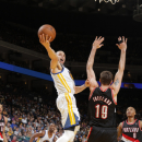 OAKLAND, CA - MARCH 30: Stephen Curry #30 of the Golden State Warriors shoots a layup against Meyers Leonard #11 of the Portland Trail Blazers on March 30, 2013 at Oracle Arena in Oakland, California. (Photo by Rocky Widner/NBAE via Getty Images)