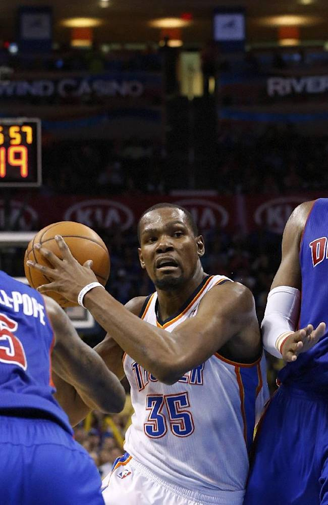 Oklahoma City Thunder forward Kevin Durant (35) drives between Detroit Pistons guard Kentavious Caldwell-Pope (15) and forward Greg Monroe (10) during the fourth quarter of an NBA basketball game in Oklahoma City, Wednesday, April 16, 2014. Oklahoma City won 112-111