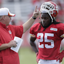 Kansas City Chiefs running back Jamaal Charles (25) listens to coach Andy Reid during NFL football training camp Sunday, July 27, 2014, in St. Joseph, Mo The Associated Press