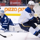Toronto Maple Leafs goalie Jonathan Bernier, left, makes a save on St. Louis Blues forward Vladimir Sobotka, right, during the first period of an NHL hockey game Tuesday, March 25, 2014, in Toronto The Associated Press