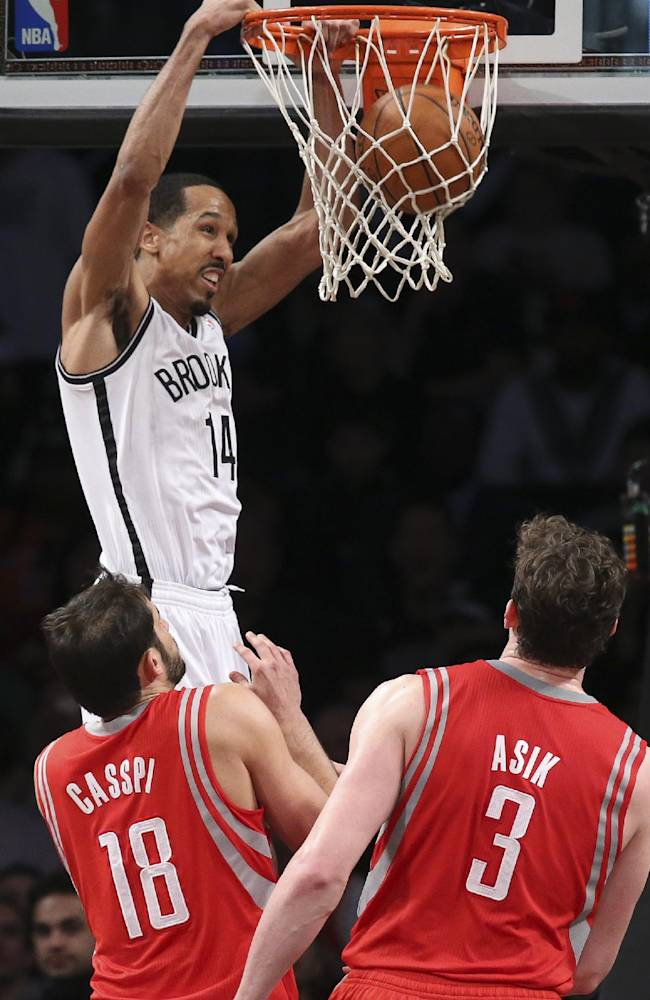 Brooklyn Nets guard Shaun Livingston (14) dunks as Houston Rockets forward Omri Casspi (18) and center Omer Asik (3) look on during the second half of their NBA basketball game at the Barclays Center, Tuesday, April 1, 2014, in New York