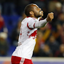 New York Red Bulls forward Thierry Henry (14) reacts after defeating Sporting Kansas City 2-1 in an MLS playoff soccer match at Red Bull Arena in Harrison, N.J., Thursday, Oct. 30, 2014 The Associated Press