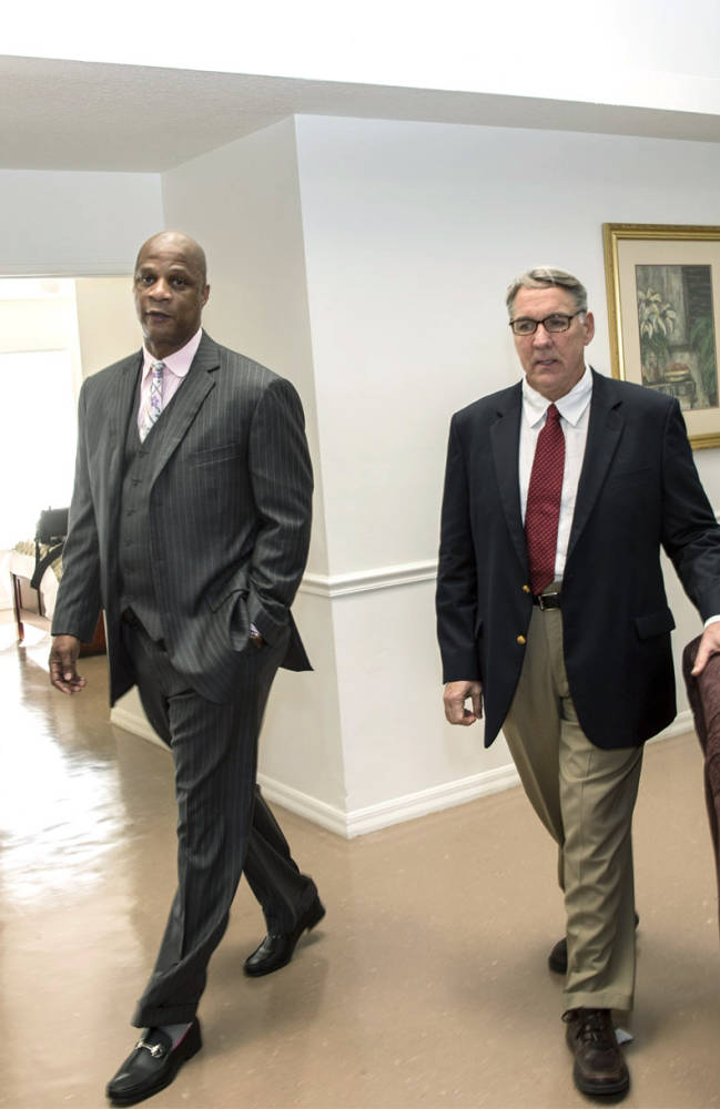 Retired baseball player Darryl Strawberry, left walks with Dr. William C. Leach inside a rehabilitation unit at the Darryl Strawberry Recovery Center, Friday, Jan. 24, 2014, in St. Cloud, Fla. The center features a program aimed at helping athletes address post-playing issues. Leach is medical director of the center