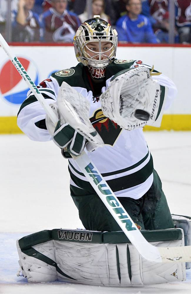 Minnesota Wild goalie Darcy Kuemper (35) blocks a shot by the Colorado Avalanche in the second period of Game 2 of an NHL hockey first-round playoff series on Saturday, April 19, 2014, in Denver