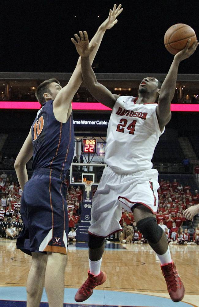 Davidson's De'Mon Brooks (24) shoots as Virginia's Mike Tobey (10) defends during the first half of an NCAA college basketball game in Charlotte, N.C., Saturday, Nov. 16, 2013