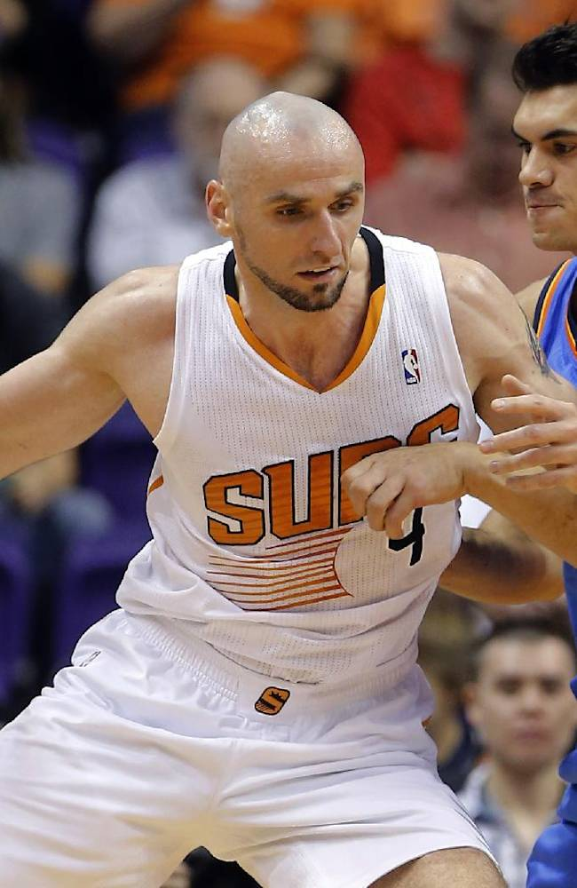 Phoenix Suns center Marcin Gortat, of Poland, backs down Oklahoma Thunder center Steven Adams, right, during the first half of an NBA preseason basketball game, Tuesday, Oct. 22, 2013, in Phoenix