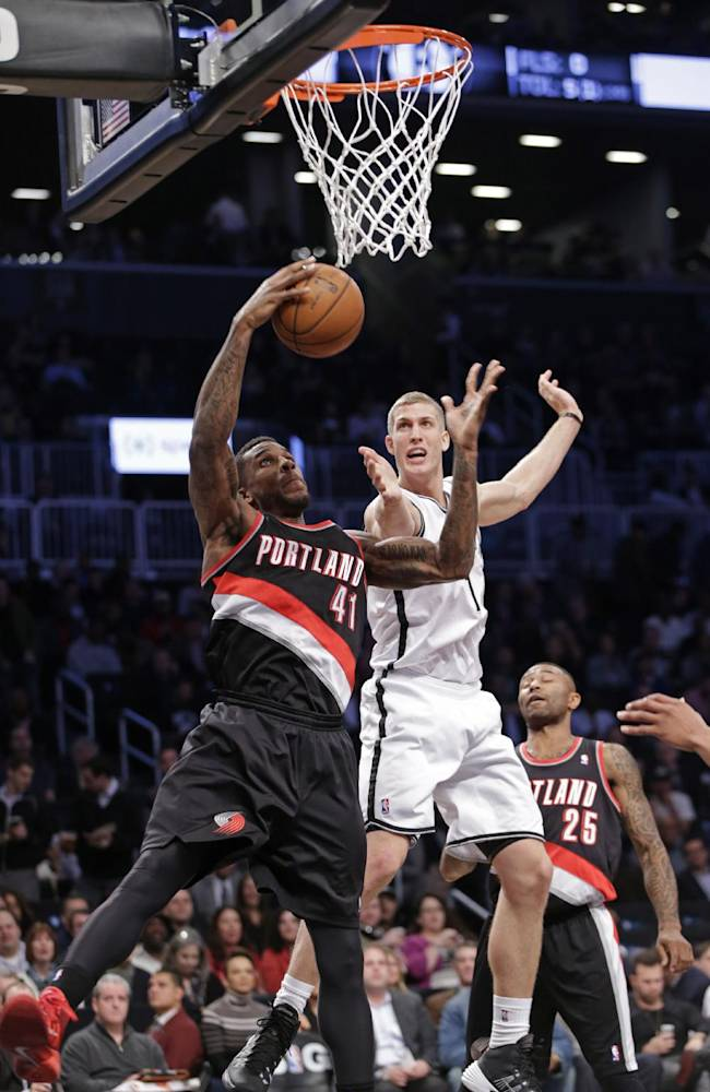 Portland Trail Blazers power forward Thomas Robinson (41) pulls down a rebound in front of Brooklyn Nets power forward Mason Plumlee (1) in the first half of their their NBA basketball game at the Barclays Center, Monday, Nov. 18, 2013, in Brooklyn