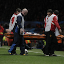 Manchester United's Robin van Persie is carried off injured during his team's during their Champions League last 16 second leg soccer match against Olympiakos at Old Trafford Stadium, Manchester, England, Wednesday, March 19, 2014