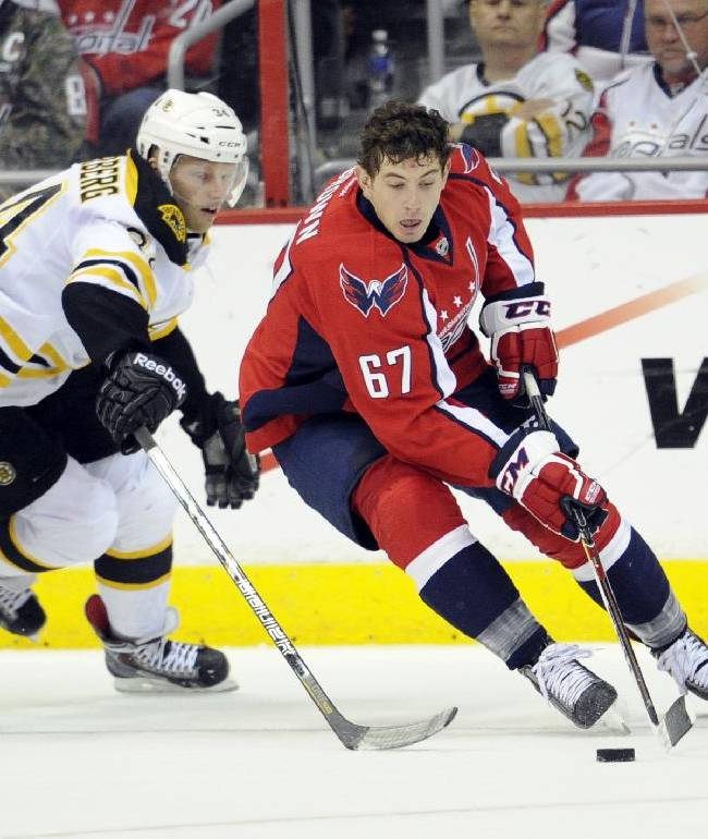 Washington Capitals center Chris Brown (67) skates with the puck against Boston Bruins center Carl Soderberg (34), of Sweden, during the second period of an NHL hockey game, Saturday, March 29, 2014, in Washington