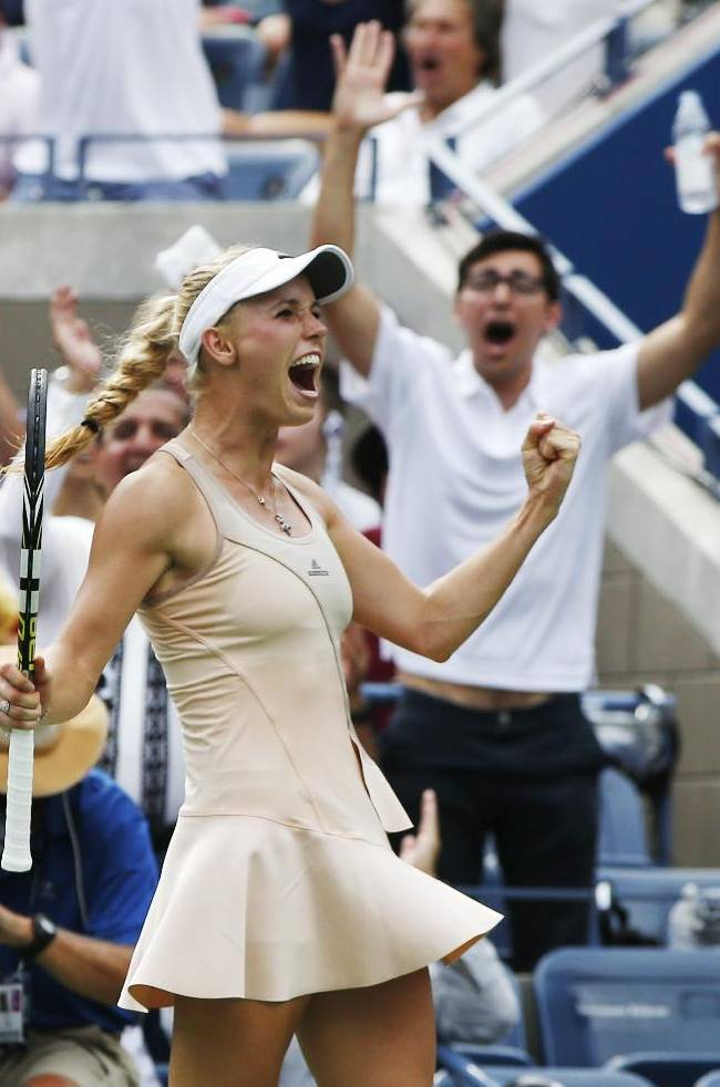 Caroline Wozniacki, of Denmark, reacts after winning a point against Maria Sharapova, of Russia, during the fourth round of the 2014 U.S. Open tennis tournament, Sunday, Aug. 31, 2014, in New York