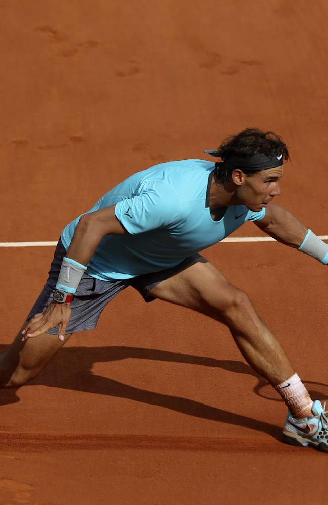 Spain's Rafael Nadal returns the ball to Serbia's Novak Djokovic during their final match of  the French Open tennis tournament at the Roland Garros stadium, in Paris, France, Sunday, June 8, 2014