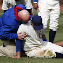 Chicago Cubs right fielder Justin Ruggiano is tended to during the ninth inning of a baseball game against the Arizona Diamondbacks at Wrigley Field in Chicago on Wednesday, April 23, 2014 The Associated Press