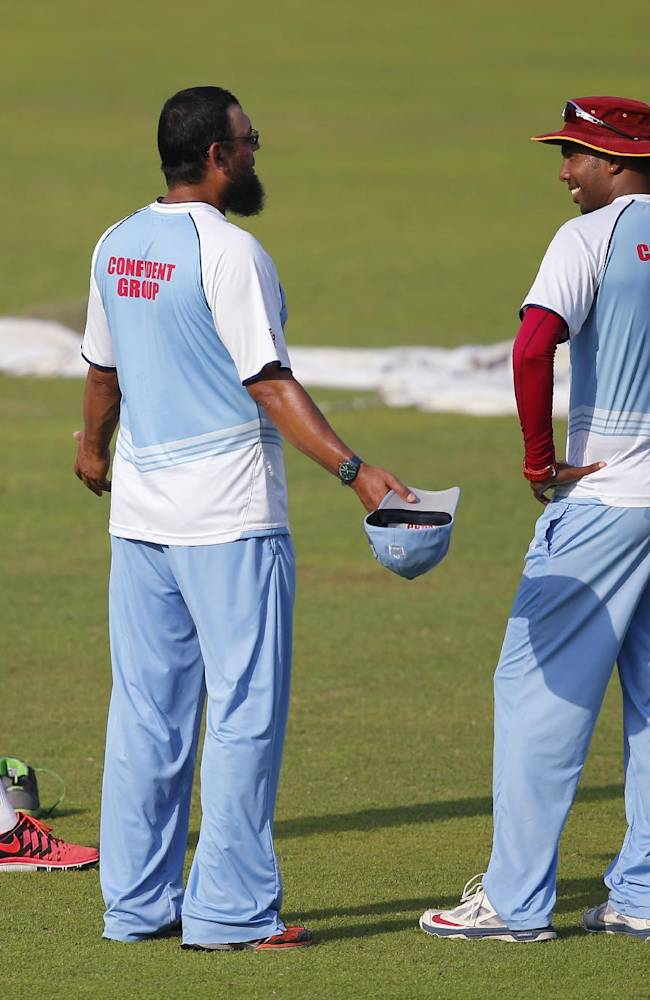 West Indies' spin bowling coach Saqlain Mushtaq, center, talks to players, Sunil Narine, left, and Samuel Badree during a training session ahead of their ICC Twenty20 Cricket World Cup match against Pakistan in Dhaka, Bangladesh, Monday, March 31, 2014