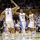 Duke's Quinn Cook (2) and Jabari Parker (1) celebrate following Parker's basket against Michigan during the second half of an NCAA college basketball game in Durham, N.C., Tuesday, Dec. 3, 2013. Duke won 79-69 The Associated Press