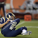 In this Aug. 23, 2014, file photo, St. Louis Rams quarterback Sam Bradford grimaces after being hit by Cleveland Browns defensive lineman Desmond Bryant in the first quarter of a preseason NFL football game in Cleveland. There is one true objective for 32