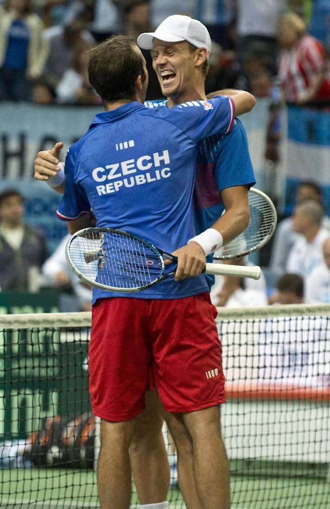 Czech Republics Tomas Berdych, right, and Radek Stepanek, left, celebrate  after defeating Argentinas Carlos Berlocq and Horacio Zeballo in their  doubles Davis Cup semifinal tennis match in Prague, Czech Republic, Saturday, Sept. 14, 2013.  Czech Republic leads by 3-0 and advanced to the final,