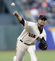 San Francisco Giants starting pitcher Ryan Vogelsong throws to the Boston Red Sox during the first inning of a baseball game Tuesday, Aug. 20, 2013, in San Francisco. (AP Photo/Marcio Jose Sanchez)