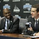 Jacque Vaughn, left, the new head coach of the Orlando Magic NBA basketball team,  listens as team general manager Rob Hennigan answers a question at a news conference, Monday, July 30, 2012, in Orlando, Fla. (AP Photo/John Raoux)