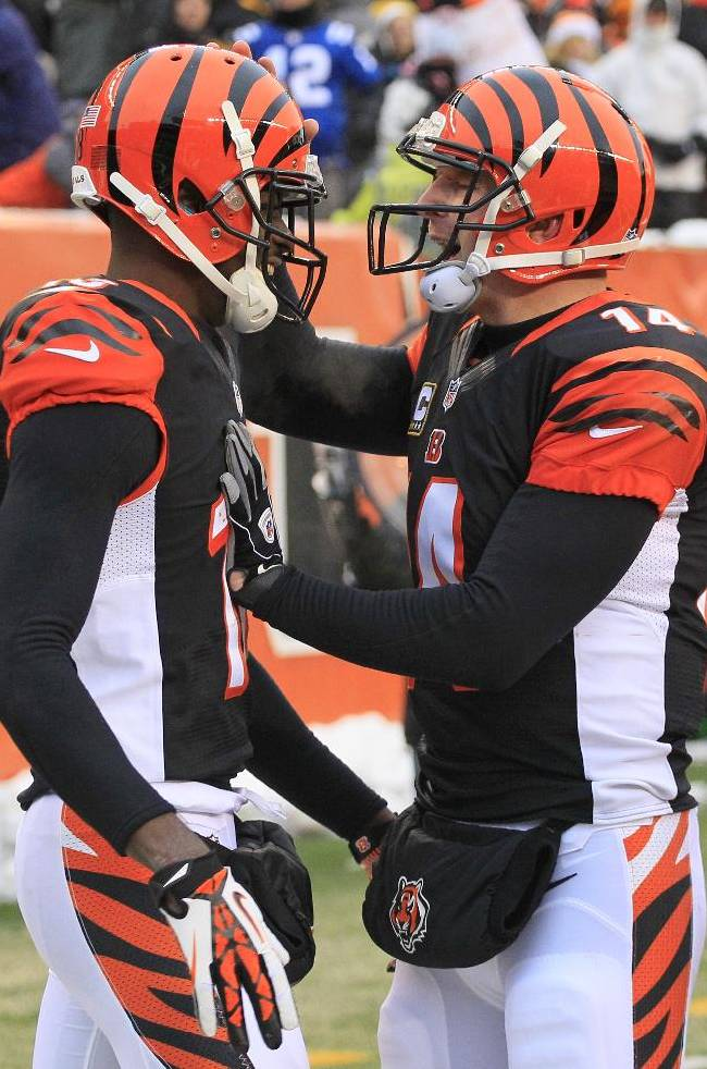 Cincinnati Bengals quarterback Andy Dalton (14) congratulates wide receiver A.J. Green (18) after Green caught a 9-yard touchdown pass from Dalton in the second half of an NFL football game against the Indianapolis Colts, Sunday, Dec. 8, 2013, in Cincinnati