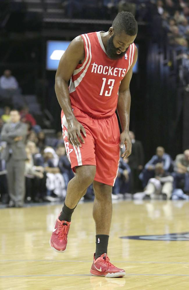 Houston Rockets' James Harden walks after injuring his knee during the first half of an NBA preseason basketball game against the Memphis Grizzlies in Memphis, Tenn., Friday, Oct. 25, 2013. The Rockets defeated the Grizzlies 92-73