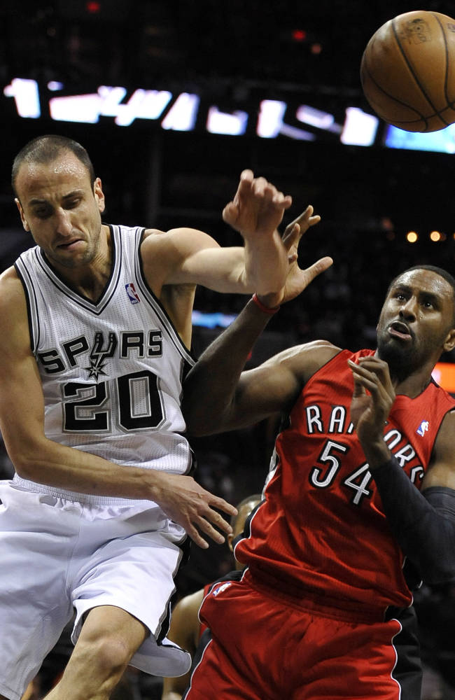 San Antonio Spurs shooting guard Manu Ginobili, left, of Argentina, defends against Toronto Raptors forward Patrick Patterson during the first half of an NBA basketball game on Monday, Dec. 23, 2013, in San Antonio