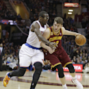 Cleveland Cavaliers' Spencer Hawes, right, drives past New York Knicks' Amare Stoudemire, left, during the first quarter of an NBA basketball game Saturday, March 8, 2014, in Cleveland. New York defeated Cleveland 107-97 The Associated Press