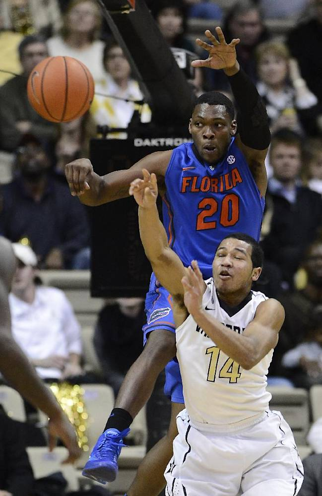 Vanderbilt guard Carter Josephs (14) is defended by Florida guard Michael Frazier II (20) in the second half of an NCAA college basketball game, Tuesday, Feb. 25, 2014, in Nashville, Tenn. Florida won 57-54