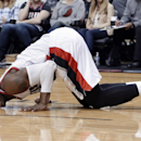 Portland Trail Blazers guard Wesley Matthews grimaces after he is fouled and knocked to the floor during the second half of an NBA basketball game against the New Orleans Pelicans in Portland, Ore., Sunday, April 6, 2014. Matthews scored 21 points as Trai